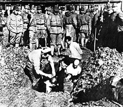 Chinese civilians being buried alive by soldiers of the Imperial Japanese Army, during the Nanking Massacre, December 1937