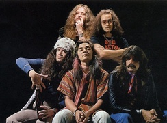 Promotional photo of Deep Purple for their 1976 UK Tour. From left to right: top row: David Coverdale, Ian Paice bottom row: Glenn Hughes, Tommy Bolin, Jon Lord