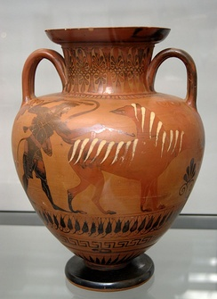 Heracles drives Cerberus ahead of him. The beast turns one of its heads back in a threatening manner and raises its snake tail. Faultily fired Attic neck amphora by the Bucci Painter, c. 540 BC, found in Vulci, now in the Munich State Collection of Antiquities