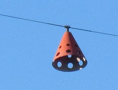 An aviation obstruction marker on a high-voltage overhead transmission line reminds pilots of the presence of an overhead line. Some markers are lit at night or have strobe lights.