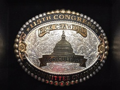 Members of the 115th Congress House Committee on Agriculture received belt buckles for their service.