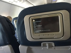 In-flight entertainment system booting up displaying the Linux logo
