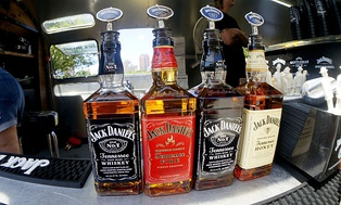 Two bottles of Jack Daniel's Black Label, one of Tennessee Fire and one of Tennessee Honey.