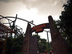 Jurassic Park entrance with Canopy Flyer in the background.