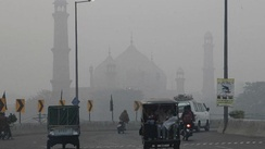 A road close to historical Badshahi mosque while dense smog engulf the neighborhood of Lahore, Pakistan, Saturday, Nov. 5, 2016