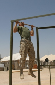A Marine performs pull-ups