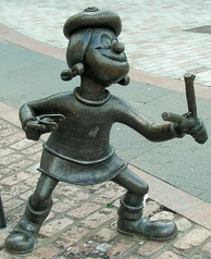 Statue of Minnie the Minx, a character from The Beano, in Dundee, Scotland. Launched in 1938, The Beano is known for its anarchic humour, with Dennis the Menace appearing on the cover.