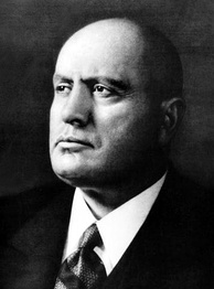 "Benito Mussolini, who claimed that the modern phase of capitalism is state socialism ""turned on its head"""