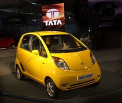 Shown here is the Tata Nano, the world's least expensive car.[120] Sanand, Gujarat, is home to Tata Nano.