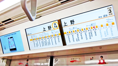 Tokyo Metro uses large LCD information display to show the current location, upcoming stops, and advertisements in several languages.