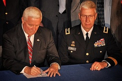 Corbett signing bills into law designed to benefit PA veterans, alongside Major General Wesley Craig.