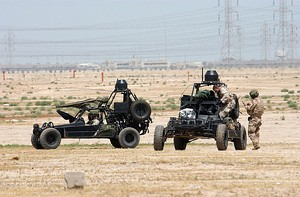 US Navy 020413-N-5362A-013 U.S. Navy SEALs (SEa, Air, Land) operate Desert Patrol Vehicles (DPV) while preparing for an upcoming mission.jpg