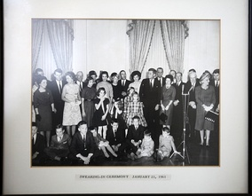 Udall (rear) standing next to Mrs. John F. Kennedy at the president's Swearing In Ceremony, January 21, 1961.