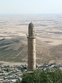Minaret of the Grand Mosque of Mardin (12th century) and the view of the Mesopotamian plains.