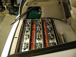15 lead–acid batteries, PFC charger, and regulators installed into WhiteBird, a PHEV-10 conversion of a Toyota Prius