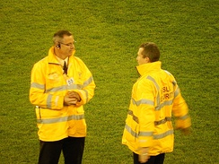 Security guards at an Australian rules football game.