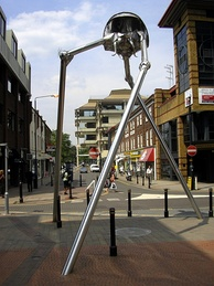 Statue of a tripod from The War of the Worlds in Woking, England. The book is a seminal depiction of a conflict between mankind and an extraterrestrial race.