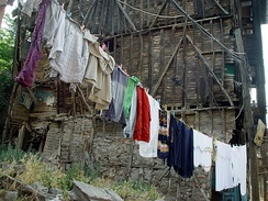 Clothes drying in ruins of a wooden house