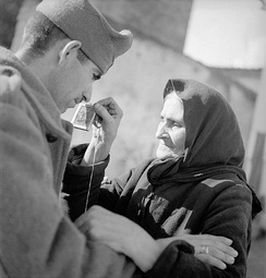 A Greek woman sees her son depart for the Albanian front.