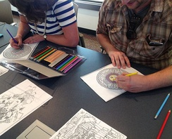 Adults coloring at the Southeast Steuben County Library