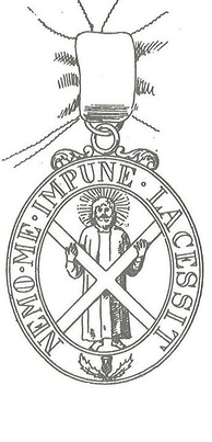 The St Andrew with the saltire in the badge of the Order of the Thistle