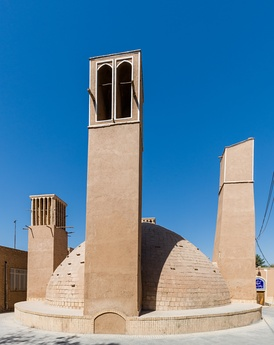 An ab anbar (water reservoir) with double domes and windcatchers (openings near the top of the towers) in the central desert city of Yazd, Iran