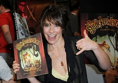 Lilly holding a copy of her children's book, The Squickerwonkers, at the 2013 San Diego Comic Con