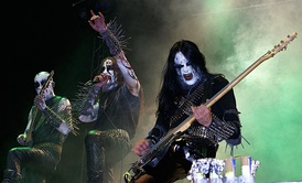 Members of Gorgoroth wearing typical black metal gear such as corpse paint, spikes and bullet belts. The band was formed by guitarist Infernus to express his Satanist beliefs.[32]