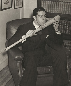 DiMaggio kisses his bat in 1941, the year he hit safely in 56 consecutive games. His wife Dorothy Arnold was pregnant with their son Joe, Jr. while the streak was in progress.[25]