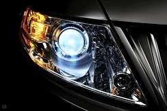 HID projector low beam headlamp illuminated on a Lincoln MKS