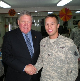 US Congressman Norm Dicks greets a US Army Soldier from Washington's 6th District at Camp Arifjan, Kuwait in 2010.