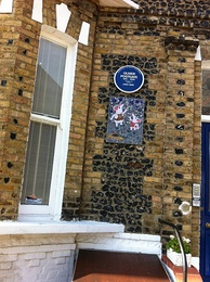 Blue plaque on Oliver's former home, with Clangers mosaic below
