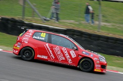 Jackson driving for AmD Tuning.com at Brands Hatch in the 2012 British Touring Car Championship.