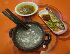 Papeda, staple food of eastern Indonesia, served with yellow soup and grilled mackerel.