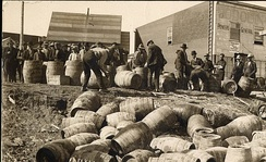 A police raid confiscating illegal alcohol, in Elk Lake, Canada, in 1925.