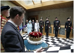 The Crown of Scotland is carried by The 16th Duke of Hamilton as Queen Elizabeth II leaves the Chamber, following the Opening of the fourth Session in July 2011.