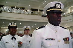 Newly graduated and commissioned officers of the Naval Reserve Officers Training Corps (NROTC) Unit Hampton Roads stand at attention as they are applauded during the spring Commissioning Ceremony in May 2004