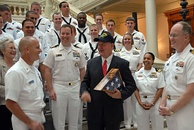 Perdue with U.S. Navy sailors in October 2010