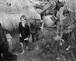 A Marine from 1st Battalion, 3rd Marines, moves an alleged Viet Cong activist to the rear during a search and clear operation held by the battalion 15 miles (24 km) west of Da Nang Air Base.
