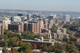 The skylines of Arlington's Courthouse and Rosslyn neighborhoods, with the Georgetown and Downtown neighborhoods of Washington, D.C. immediately past them. The county accounts for most of Virginia's border with the District.