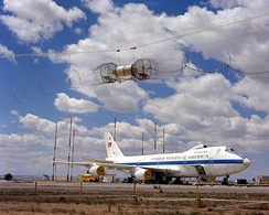 A right front view of an E-4 advanced airborne command post (AABNCP) on the nuclear electromagnetic pulse (EMP) simulator for testing.