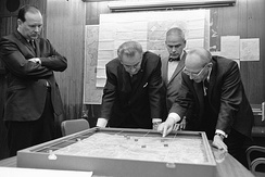 Situation Room: National Security Advisor Walt Rostow showing President Lyndon B. Johnson a model of the Khe Sanh area on February 15, 1968