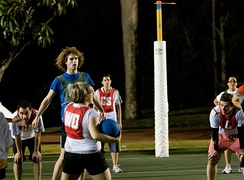 Men and women play together during a mixed netball game in Australia.