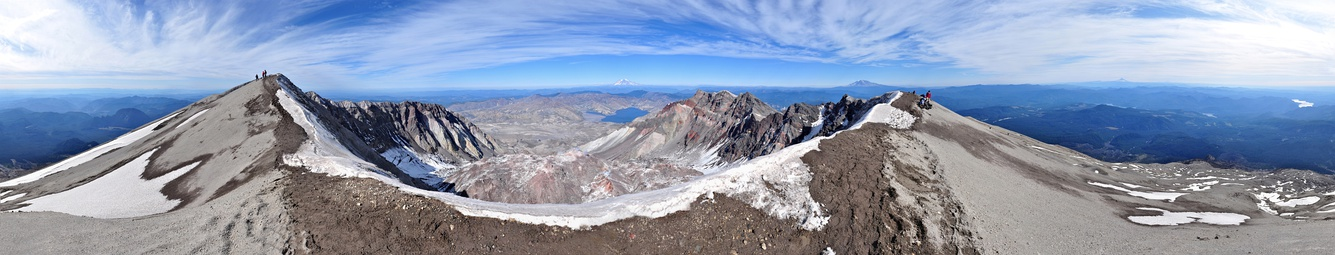360° panorama from the summit of Mount St. Helens as seen in October 2009. In the foreground is the ice-covered crater rim. Visible in the lower center is the lava dome. Steam rises from several dome vents. Above the dome, in the upper center, lies Mount Rainier and Spirit Lake. Mount Adams appears to the right of Rainier on the horizon as well as Mount Hood and Mount Jefferson on the far right. Also on the far right are glimpses of the Swift Reservoir, Yale Lake, Lake Merwin and the Lewis River. Climbers stand on the crater rim and are visible along the Monitor Ridge climbing route.