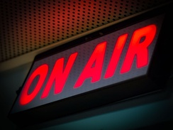 On Air sign illuminated usually in red while recording or broadcasting