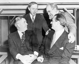 Progressive Citizens of America party members. Left to right, seated, are Henry A. Wallace and Elliott Roosevelt; standing are Dr. Harlow Shapley and Jo Davidson.