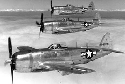 Republic P-47N-5 in three ship formation.