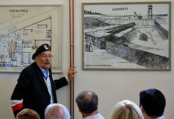 Samuel Willenberg showing his drawings of the Treblinka extermination camp