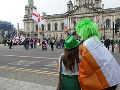 People carrying the Irish flag, overlooking those with the unionist Ulster Banner