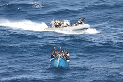 Suspected Somali pirates keep their hands in the air